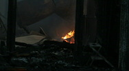 Fire inside of burned house at night P HD 7915 Stock Footage