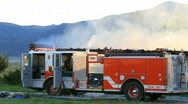 Fire truck by burning house P HD 7881 Stock Footage