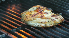 BBQ Chicken Breast On A Grill With Flames Stock Footage