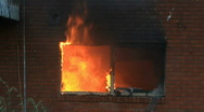 House fire flames through window P HD 7903 Stock Footage