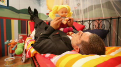 Mature man playing in children;s bedroom Stock Footage