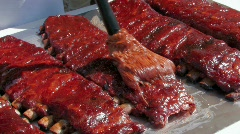 Chef Basting juicy barbecue ribs Stock Footage