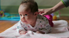 Happy baby lying on her stomach - stock footage