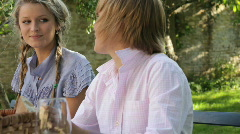 WS, Family in garden eating and talking at dinner table Stock Footage