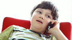 Young boy talking on mobile phone Stock Footage