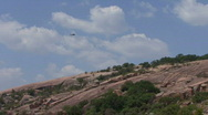 Helicopter flying over Texas Hills Stock Footage