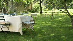 PAN, Empty set table in domestic garden Stock Footage