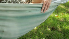 Mother and daughter in hammock sleeping in garden Stock Footage