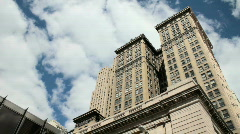 Buildings against sky pan Stock Footage