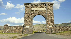 Stone Arch Entrance into Yellowstone National Park, Cars Enter Park - Time Lapse Stock Footage