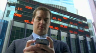 Business man and smart phone Stock Footage