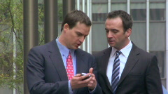 Two men with smart phone Stock Footage
