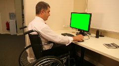 Stock Video Footage of Businessman with wheelchair in office