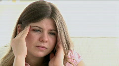 Young girl crying because of headache Stock Footage