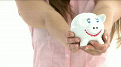 Close up of a teenager holding a piggybank Stock Footage