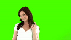 Joyful woman against a green screen Stock Footage