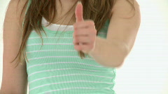 Close-up of a teenager doing a thumbs up Stock Footage