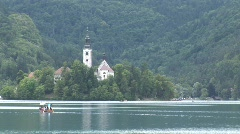 Gondola in front of church on lake bled Stock Footage