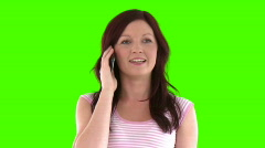 Beautiful woman answering to the phone Stock Footage