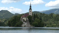 gothic church on island  in glacial lake Bled - stock footage