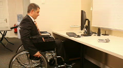 Successful businessman with wheelchair - stock footage