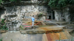 Zookeeper, washing the grotto Stock Footage