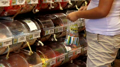 Woman in candy shop Stock Footage