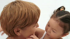 Hugging mother and daughter Stock Footage