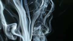 Smoke against a black background - stock footage