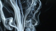 Stock Video Footage of Smoke against a black background