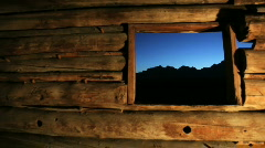 Grand Tetons Through Window of Old Pioneer Log Cabin - National Park Stock Footage
