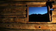 Stock Video Footage of Grand Tetons from Old Pioneer Log Cabin 1-HD