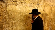 Stock Video Footage of Orthodox Jewish Rabbi prays at the Western Wall in Jerusalem, Israel