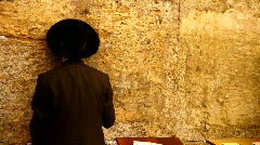 Orthodox Jewish Rabbi prays at the Western Wall in Jerusalem, Israel Stock Footage