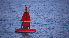 Red buoy in blue water Stock Footage