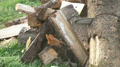 cut wood with axe - stock footage