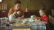 Family breakfast in the 1960s (vintage 8 mm amateur film) Stock Footage
