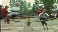 Stock Video Footage of Merry-go-round on 1960's playground (vintage 8 mm amateur film)