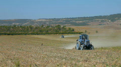 Two tractor plowing a field Stock Footage