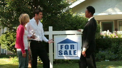 Real estate agent showing couple a house Stock Footage