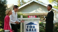 Young couple buying a house - stock footage