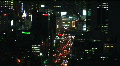 Aerial urban landscape view of Tokyo with skyscrapers, Japan. Zoom out / Night. Footage