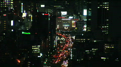 Aerial urban landscape view of Tokyo with skyscrapers, Japan. Zoom out / Night. - stock footage