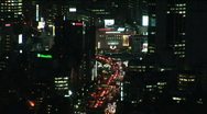 Aerial urban landscape view of Tokyo with skyscrapers, Japan. Zoom out / Night. Stock Footage