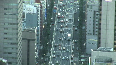 Trafic jam in a big city. Aerial view of Tokyo, Japan. Zoom out.  - stock footage