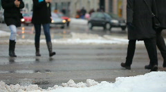 Car driving and people on the snow wet street Stock Footage