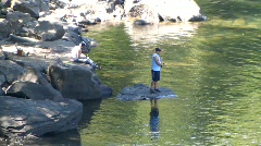 Fisherman on the Shores of a Rocky River (HD) co Stock Footage