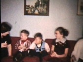 Stock Video Footage of Kids Singing Christmas Carols (1958 Vintage 8mm)
