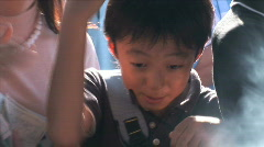 Childrens doing the ritual for protection at Asakusa temple in Tokyo, Japan Stock Footage