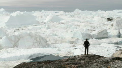 Tourist walking in front of glacier Stock Footage